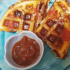 Whether it's breakfast or lunch, these pizza waffles are the perfect choice. Personalize them yourself by getting creative with the toppings.