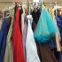"Racks of prom dresses and men's jackets are available to prom goers in room 113 . Attire and accessories are free of charge to students who are unable to pay the costs of prom wear. ""Many alumni outgrow the dresses, or will never go to a prom again, or will get another gown,"" Student Activities Coordinator John Goto said, ""so there are always others who can use it to save their money for other things."""