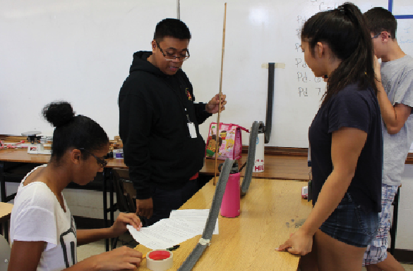 "Physics students Arianna Gaskins (12), Kriztofer Caraang (12), Angela Peralta (12), and Mitchell Gawlik (12) investigate the concept of roller coasters to learn about mechanical energy and conservation of energy. Through a self-study process, teachers are involved in making sure that students are engaged and learning. ""Physics is a fun, hands on class where we can do a lot of formative assessment to ensure our students are understanding the concepts,"" science teacher Teresa Williams said."