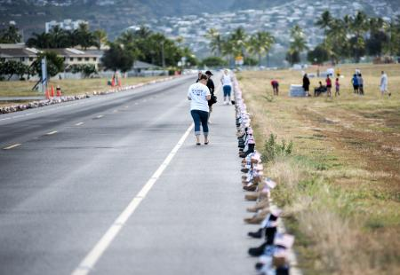 Boots lined up the Ford Island runway for the 8K Hero and Remembrance Run. (U.S. Navy photo by Mass Communication Specialist Seaman Johans Chavarro)
