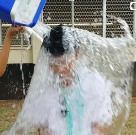 "Sierra Macias (12) assists reporter Algeo Rosario (12) with his Ice Bucket Challenge by personally dousing him with ice water. Dozens of Rams have taken up the challenge, and join thousands of people around the world to promote awareness of ALS. ""The ice water was ridiculously cold,"" Rosario said, ""but it's all for a good cause."""