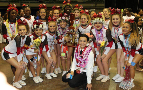 """This is at the state competition at Blaisdell Nov. 14. 11th consecutive title. """"""""We're a very hardworking team and we work to keep our legacy alive,"""" Shayla Rice (12) said."""