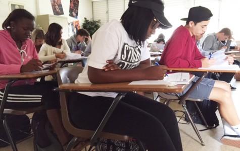 Advanced Placement students Brigina Terry (12), Zakiyah Stowe (12), and Jacob Nino (12) take an exam in their AP Language class.
