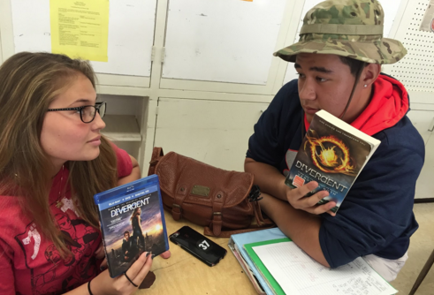 "Keely Beck (12) and Alex Gibson (11) debate on the issue of books and movies. Many see movies as a better representation of a story, while others prefer to create their own story with books. ""I'd rather watch the movie, it's more interesting,"" Beck said. (Photo by Adaliah Collins)"