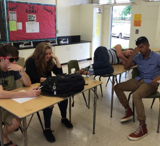 """Seniors Ronan McElveny, Emma Winters, Katie Hearther, and Maximillion Philson pose as victims of senioritis. Senioritis is an affliction that seniors experience when they are ready to graduate, and have no motivation to do their best when completing assignments. """"Seniors can get lazy, but they can't just slack off,"""" Bryce Edmonson (12) said. """"They'll fail."""""""