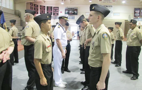 """Commander Corey Turner, from the US Navy conducted the Annual Military Inspection. He inspected classrooms' physical conditions and teaching equipment, and checked supply and record keeping procedures.  """"I did AMI last year and compared to this year it was a fun experience,"""" Christian Limos (10) said."""
