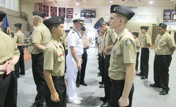 "Commander Corey Turner, from the US Navy conducted the Annual Military Inspection. He inspected classrooms' physical conditions and teaching equipment, and checked supply and record keeping procedures.  ""I did AMI last year and compared to this year it was a fun experience,"" Christian Limos (10) said."