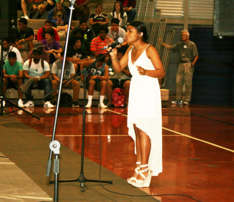 """Female vocalist Ciara Arthur (11) takes first place with her song """"Hallelujah."""""""