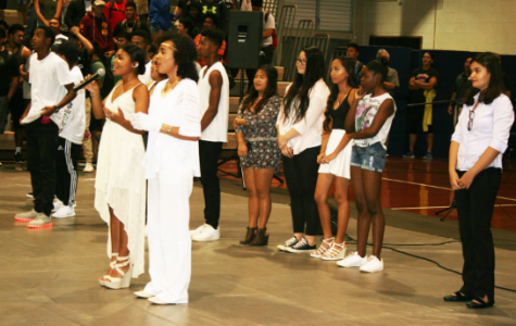 Brown Bags contestants lead the school in singing the alma mater at the end of the talent show assembly.