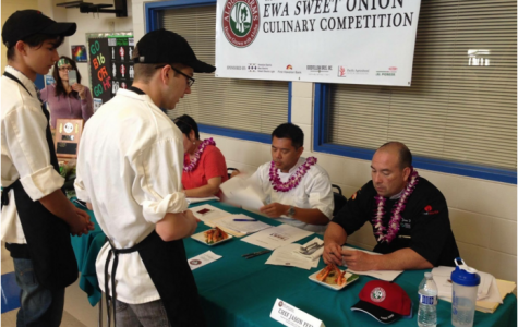 """Culinary students Evan Collins (11) and Jeremiah Joswick (11) at the Aloun Farms 3rd Annual Ewa Sweet Onion Culinary Competition. The objective of the competition is to cook a dish with the items assigned to your team. """"It was a good learning experience,"""" Joswick said. (Photo submitted by Evan Collins)"""