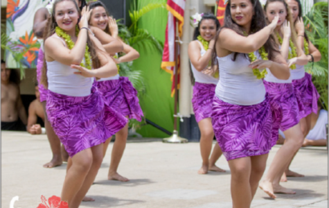 """Ladies take to the stage and dance the hula auana, or modern hula. Kayce Demello (11), who participated in the hula and Tahitian dances, said, """"I felt like a lot of people enjoyed it. Hopefully, we can put it out to a big assembly again."""" (Photos by CJ Caraang)"""