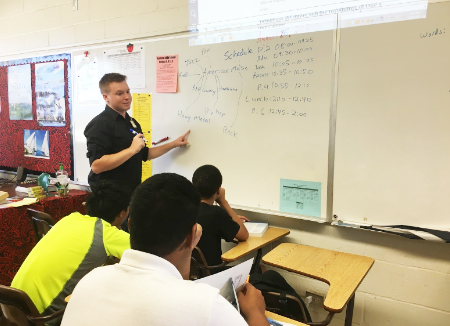 """English resource teacher Nathan Krahn breaks down American music to his sophomore English class. He is a transplant from Washington who shares the same distinction as most of the students at the school. """"I am an Air Force child, so I have lived in various places,"""" he said."""