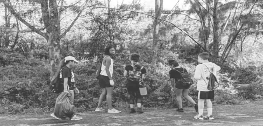 Freshmen Bridget Estabillo, Sarah Mack, Serafina Cid-Ross, Arianna Medina, and Cameron Hindel collect trash at Kalaeloa Beach.