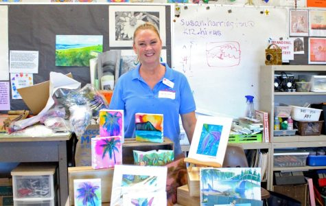 Jenny Floro, an Artist for HouseMart Ben Franklin Crafts presented her paintings in  Fine Arts teacher Susan Harrington's room.